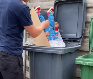 Marie the beagle vs chucky. chucky in trash